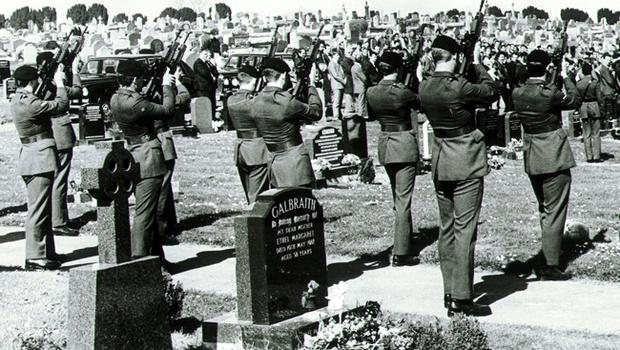UDR colleagues fire a volley of shots over the grave of Private Steven Smart, at Movilla Cemetary. Private Smart was killed along with three others after an IRA bomb blew up their Land Rover in Downpatrick. 13/04/90