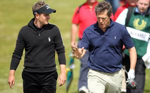 Luke Donald of England (left) walks with Hugh Grant, Hollywood actor, during the second round of The JP McManus Invitational Pro-Am event at the Adare Manor Hotel and Golf Resort on July 6, 2010 in Limerick