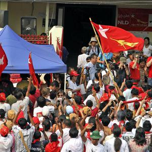 Supporters of democracy leader Aung San Suu Kyi gather outside the party headquarters in Yangon (AP/Khin Maung Win)