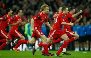LONDON, ENGLAND - FEBRUARY 26:  Liverpool players celebrate their penalty shoot out victory after the Carling Cup Final match between Liverpool and Cardiff City at Wembley Stadium on February 26, 2012 in London, England. Liverpool won 3-2 on penalties.  (Photo by Paul Gilham/Getty Images)