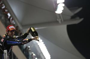 ABU DHABI, UNITED ARAB EMIRATES - NOVEMBER 14:  Sebastian Vettel of Germany and Red Bull Racing celebrates on the podium after winning the driver's championship during the Abu Dhabi Formula One Grand Prix at the Yas Marina Circuit on November 14, 2010 in Abu Dhabi, United Arab Emirates.  (Photo by Vladimir Rys/Getty Images)