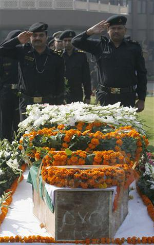 National Security Guard commandoes pay tribute to commando Gajendra Singh, in New Delhi, India, Saturday, Nov. 29,  2008. Indian commandos killed the last remaining gunmen holed up at a luxury Mumbai hotel Saturday, ending a 60-hour rampage through India's financial capital by suspected Islamic militants that killed people and rocked the nation. (AP Photo/Mustafa Quraishi)