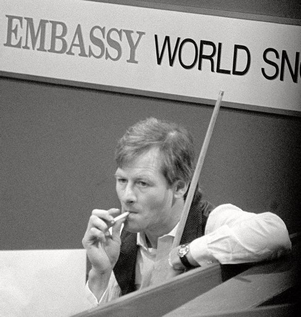 21-04-1986, Alex Higgins enjoys a cigarette during a moment's break during the Embassy World Snooker Championship match against John Spencer in Sheffield.
