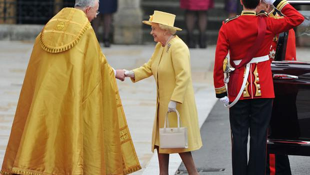 LONDON, ENGLAND - APRIL 29:  Queen Elizabeth II and Prince Philip, Duke of Edinburgh are greeted by The Right Reverend Dr John Hall, Dean of Westminster as they arrive to attend the Royal Wedding of Prince William to Catherine Middleton at Westminster Abbey on April 29, 2011 in London, England. The marriage of the second in line to the British throne is to be led by the Archbishop of Canterbury and will be attended by 1900 guests, including foreign Royal family members and heads of state. Thousands of well-wishers from around the world have also flocked to London to witness the spectacle and pageantry of the Royal Wedding.  (Photo by Pascal Le Segretain/Getty Images)