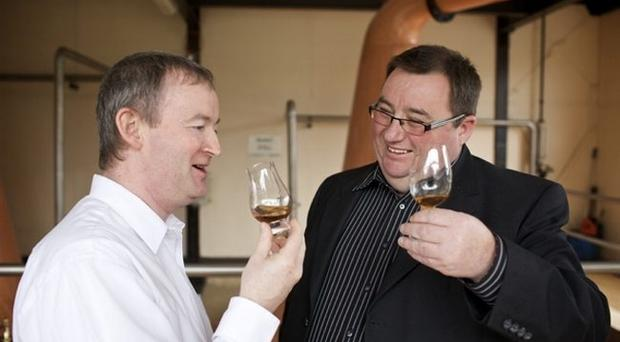 Lottery winner Peter Lavery (right) checks out the first glass of Danny Boy Premium Blend whiskey, his latest business venture with Cooley head distiller Noel Sweeney
