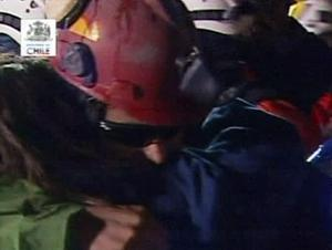In this screen grab taken from video, Florencio Avalos, the first miner to be rescued, center, is greeted after his rescue at San Jose Mine near Copiapo, Chile. (AP Photo)