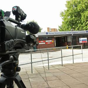 A TV camera outside the entrance to News International in Wapping, London