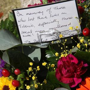 A message in wreaths at the Titanic Memorial in Belfast's City Hall grounds