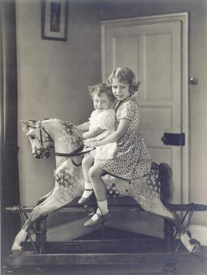 Princess Elizabeth and Princess Margaret riding a rocking horse at St. Paul's Waldenbury in August 1932