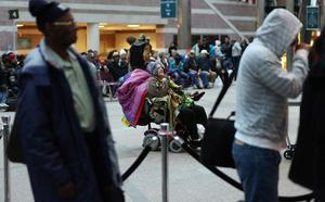 ATLANTIC CITY, NJ - OCTOBER 28: People wait to be evacuated by bus from the Atlantic City Convention Center ahead of Hurricane Sandy on October 28, 2012 in Atlantic City, New Jersey. Governor Chris ChristieÄôs emergency declaration is shutting down the cityÄôs casinos and 30,000 residents are being told to evacuate. (Photo by Mario Tama/Getty Images)