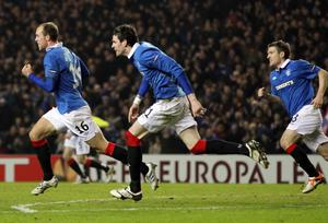 GLASGOW, SCOTLAND - FEBRUARY 17:  Steven Whittaker of Rangers celebrates scoring with a header during the UEFA Europa League, round of 32, first leg football match between Glasgow Rangers and Sporting at Ibrox Stadium on February 17, 2011 in Glasgow, Scotland. (Photo by Ian MacNicol/Getty Images)