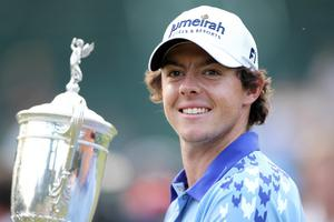 BETHESDA, MD - JUNE 19:  Rory McIlroy of Northern Ireland poses with the trophy after his eight-stroke victory on the 18th green during the 111th U.S. Open at Congressional Country Club on June 19, 2011 in Bethesda, Maryland.  (Photo by Jamie Squire/Getty Images)