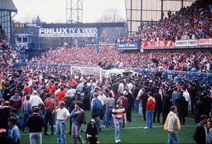 Fans on the pitch at Hillsborough. FA Cup semi final April 1989 between Liverpool and Nottingham Forest.  96 football fans lost their lives in Britain's worst stadium disaster