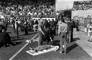 Fans receiving attention on the pitch. Hillsborough stadium in Sheffield will always bear the scar of England's worst football tragedy. On April 15th 1989, 96 Liverpool fans lost their lives having gone to watch their side contest an FA Cup semi-final against Nottingham Forest