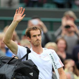 Andy Murray celebrates defeating Croatia's Marin Cilic during day eight of the 2012 Wimbledon Championships
