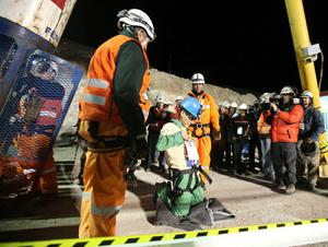 SAN JOSE MINE, CHILE - OCTOBER 13: (NO SALES, NO ARCHIVE) In this handout from the Chilean government, Carlos Mamani, 23, becomes the fourth miner to exit the rescue capsule, on October 13, 2010 at the San Jose mine near Copiapo, Chile. The rescue operation has begun bringing up the 33 miners, 69 days after the August 5, 2010 collapse that trapped them half a mile underground. (Photo by Hugo Infante/Chilean Government via Getty Images)