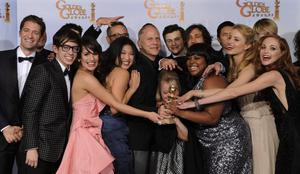 "The cast and crew of ""Glee,"" pose with the award they won for Best Television Series - Comedy Or Musical at the Golden Globe Awards Sunday, Jan. 16, 2011, in Beverly Hills, Calif. (AP Photo/Matt J. Terrill)"