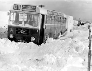 A U.T.A. bus which was abandoned in deep snow-drifts on the main Larne-Ballymena road at Shane's Hill.   30/11/1965