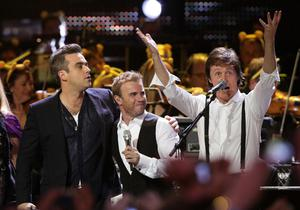 From left: Robbie Williams, Take That's Gary Barlow and Sir Paul McCartney join stars on stage for a special performance at the BBC Children in Need Rocks concert, at the Royal Albert Hall