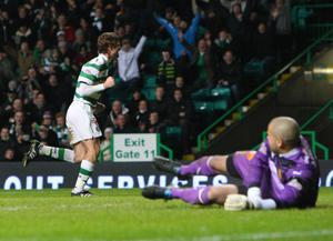 Celtic's Paddy McCourt celebrates the opening goal during the Clydesdale Bank Scottish Premier League match at Celtic Park, Glasgow.