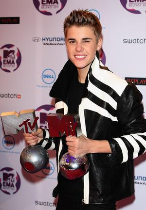 BELFAST, NORTHERN IRELAND - NOVEMBER 06:  Singer Justin Bieber with awards attends the MTV Europe Music Awards 2011 at Odyssey Arena on November 6, 2011 in Belfast, Northern Ireland.  (Photo by Danny Martindale/Getty Images)