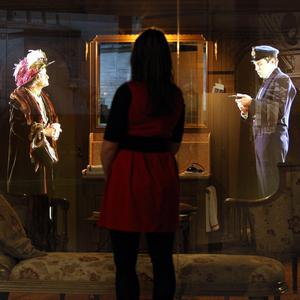 A visitor views an interactive hologram feature inside the Titanic Belfast