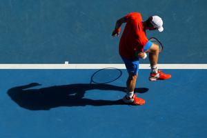 MELBOURNE, AUSTRALIA - JANUARY 25:  Andy Murray of Great Britain juggles his racket in his quarterfinal match against Kei Nishikori of Japan during day ten of the 2012 Australian Open at Melbourne Park on January 25, 2012 in Melbourne, Australia.  (Photo by Mark Kolbe/Getty Images)