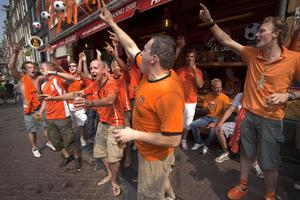 Soccer fans gather in Amsterdam's red light district, Netherlands, Sunday, July 11, 2010, ahead of the World Cup soccer final match between Netherlands and Spain