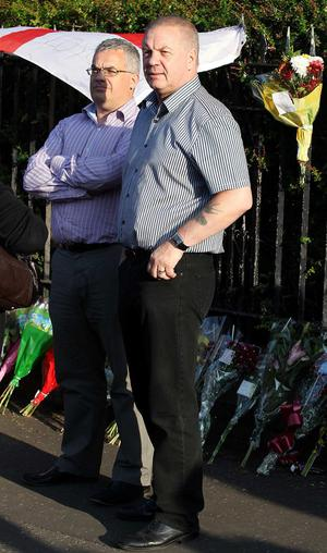 The SDLP's Tim Attwood (left) and Raymond McCord whose son Raymond McCord Jnr was murdered by the UVF attend the vigil on the Shankill Road in west Belfast for 43-year-old Bobby Moffett who was shot and killed.