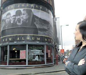 Caitlin McCormack, who works in Frames Bar, looks at the poster for Killing Bono