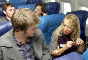 ames Ferguson and Ashleigh Watson speed date on the plane