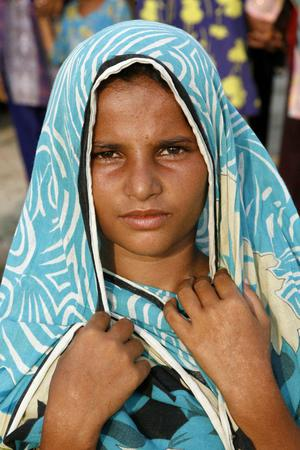 A young girl, who is a Pakistani flood survivor, is shown in the Sultan Colony, an refuge encampment, in the Province of Punjab, near the city of Multan, Pakistan. Pakistan is suffering from the worst flooding in 80 years as the army and aid organizations struggle to cope with the scope of the wide spread scale of the disaster which has killed thousands and displaced millions.