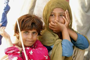 Two young girls, who are Pakistani flood survivors are shown in the Sultan Colony
