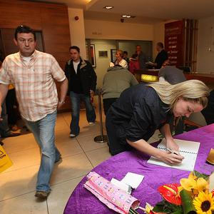 Members of the public sign a book of condolences for Gerry Ryan