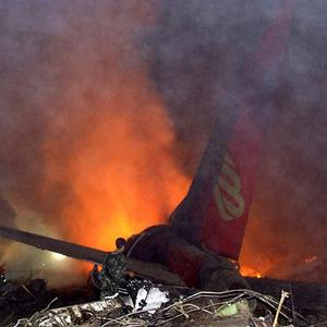 A Henan Airlines plane crashed in north-east China, killing 43 people (AP)