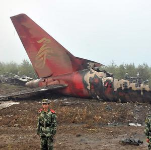 The wreck of a Henan Airlines plane which crashed on landing in Yichun, north east China (AP)