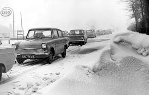 These cars found the Belfast-Aldergrove road very tricky as they manoeuvred slowly along on the hard packed snow.   16/2/1966
