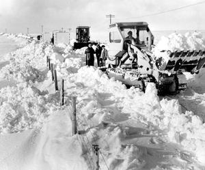 Snow plough trying to clear the drifts blocking the main Larne-Ballymena road at Shane's Hill.    30/11/1965