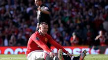 MANCHESTER, ENGLAND - SEPTEMBER 18:  Wayne Rooney of Manchester United reacts after slipping and missing a penalty kick during the Barclays Premier League match between Manchester United and Chelsea at Old Trafford on September 18, 2011 in Manchester, England.  (Photo by Clive Brunskill/Getty Images)