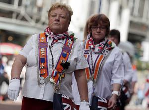 Northern Ireland- 12th July 2012 Mandatory Credit - Photo-Jonathan Porter/Presseye.  Annual 12th July celebrations and Orange Order parades take place in Belfast and across Northern Ireland.  The day commemorates the victory of William of Orange over King James at the Battle of the Boyne in 1690.  Orange women pictured on Royal Avenue as the main parade makes its way through Belfast City Centre.