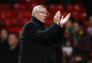 MANCHESTER, ENGLAND - NOVEMBER 28:  Sir Alex Ferguson manager of Manchester United applauds the crowd after the Barclays Premier League match between Manchester United and West Ham United at Old Trafford on November 28, 2012 in Manchester, England.  (Photo by Clive Brunskill/Getty Images)