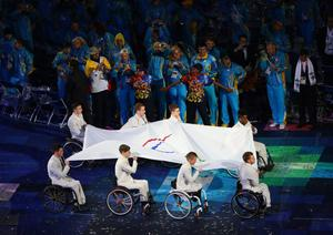 LONDON, ENGLAND - AUGUST 29:  The Paralympic flag is carried by members of the Great Britain U22 Wheelchair basketball team during the Opening Ceremony of the London 2012 Paralympics at the Olympic Stadium on August 29, 2012 in London, England.  (Photo by Mike Ehrmann/Getty Images)