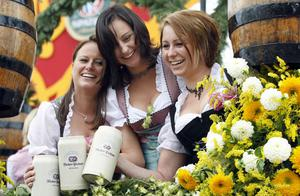 Young women seen with their beer steins while riding a decorated coach to the opening of the famous Oktoberfest beer festival in Munich, southern Germany, Saturday, Sept. 19, 2009. Some six million visitors from around the globe are expected to come to the Bavarian capital, until the end of the world famous beer festival on Oct. 4, 2009. (AP Photo/Matthias Schrader)
