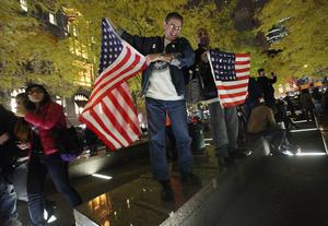 NEW YORK, NY - NOVEMBER 15:  Occupy Wall Street Protesters celebrate after re-entering Zuccotti Park on November 15, 2011 in New York City. Police had removed the protesters from the park early in the morning. A judge ruled that protesters are allowed back to the park but won't be allowed to camp there. Hundreds of protesters, who rallied against inequality in America, have slept in tents and under tarps since September 17 in Zuccotti Park, which has since become the epicenter of the global Occupy movement. The raid in New York City follows recent similar moves in Oakland, California, and Portland, Oregon.   (Photo by Mario Tama/Getty Images)