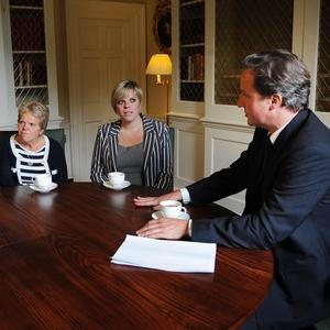 Prime Minister David Cameron with Milly Dowler's mother Sally and sister Gemma
