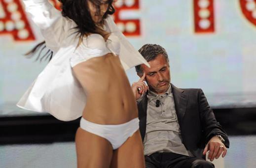 Jose Mourinho's best moments: Would you like me to lapdance for you? Jose Mourinho made an appearance on Italian television show Chiambretti Night, shortly after his move to Italy. As England manager Fabio Capello once found out, part of the show involves a private dance from a scantily clad woman. Mourinho appeared to find it difficult to stay awake for the performance.