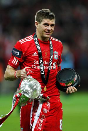 LONDON, ENGLAND - FEBRUARY 26:  Steven Gerrard of Liverpool celebrates with the trophy after victory in the Carling Cup Final match between Liverpool and Cardiff City at Wembley Stadium on February 26, 2012 in London, England. Liverpool won 3-2 on penalties.  (Photo by Paul Gilham/Getty Images)