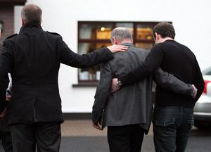 Mickey Harte (centre), is comforted at the family home outside Ballygawley in Co Tyrone