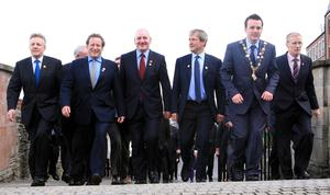 The Mayor of Derry, Councillor Colum Eastwood, leads guests on a tour of Derry historic walls. Included, from left are First Minister Peter Robinson, Deputy First Minister Martin McGuinness, Ed Vaizey, Minister for Culture, Communications and Creative Industries, Mark Durkan, MP, Secretary of State Owen Paterson, and Gregory Campbell MP