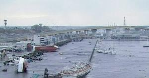 In this video image taken from Japan's NHK TV, ships and boats are washed ashore in Hachinohe, Aomori Prefectur, Japan